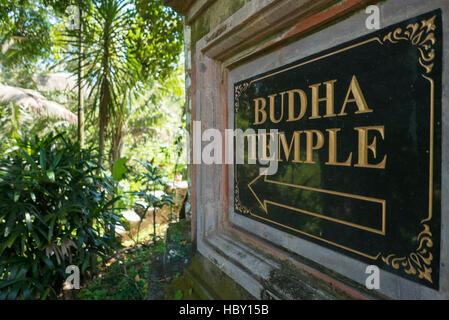 Sign to Buddha temple in Ubud, Bali Island. Indonesia - Stock Photo