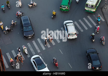 Motorcycles, cars, and pedestrian crossing at Ben Thanh roundabout, Ho Chi Minh City (Saigon), Vietnam - Stock Photo