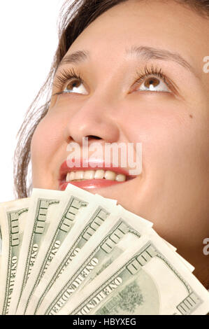 Happy woman holding hundred dollar bills in her hands - Stock Photo