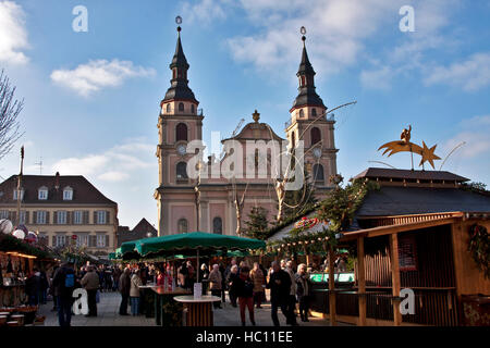 Christmas craft market at Ludwigsberg, Germany, shoppers at craftsmen's booths under baroque themed decor that lights - Stock Photo