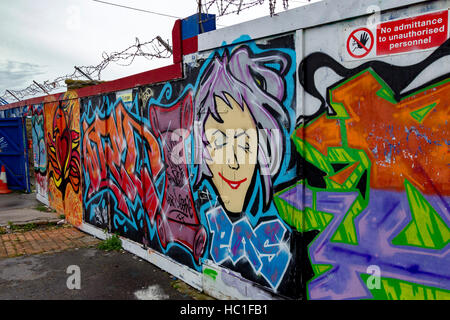 Graffiti on boarding to stop people entering the entrance to the derelict Birbeck Pier, Weston Super Mare. - Stock Photo