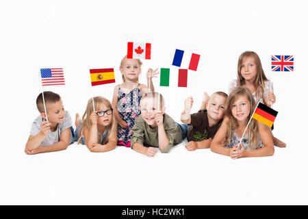 poland group holding flags of different countries. German flag, flag england, spain, america, russia, france flag, - Stock Photo