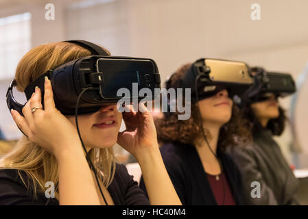 London, UK.  7 December 2016.  Visitors test virtual reality headsets at the preview of Mathematics: The Winton - Stock Photo