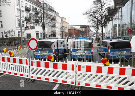 Police vehicles parked on a closed road around the exhibition halls in Hamburg, Germany, 7December 2016. Around - Stock Photo