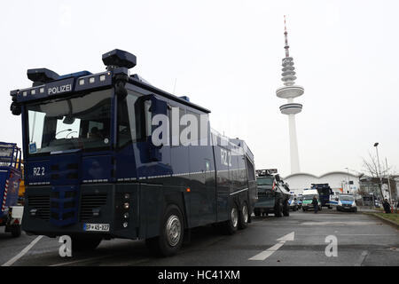 Water cannon and other police vehicles near the exhibition halls in Hamburg, Germany, 7December 2016. Around 50 - Stock Photo