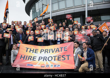 London, UK. 8th December, 2016. Private hire vehicle drivers belonging to the GMB trade union protest outside City - Stock Photo