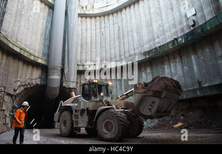 Stuttgart, Germany. 08th Dec, 2016. A construction worker in front of a digger during a tour of the building site - Stock Photo