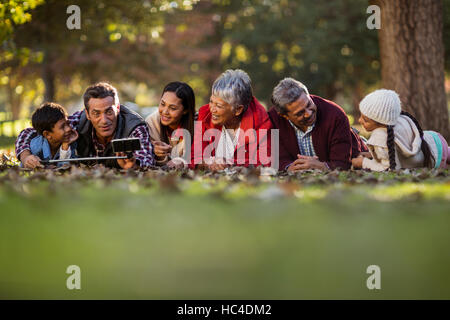 Man with family taking selfie - Stock Photo