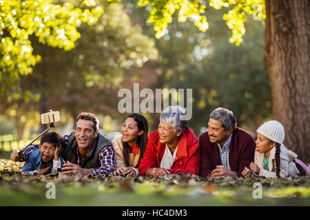 Man with joyful family taking selfie - Stock Photo
