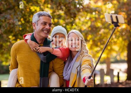 Smiling family taking selfie - Stock Photo