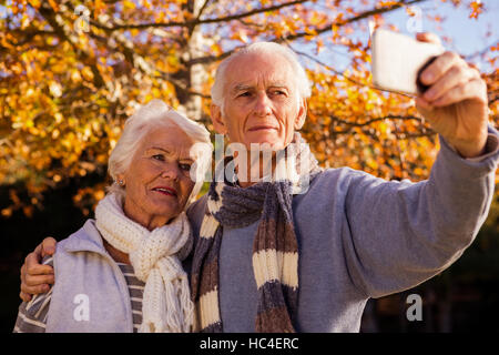 Senior couple taking a selfie - Stock Photo