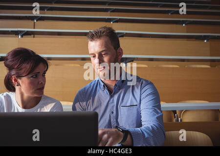Mature students using laptop - Stock Photo