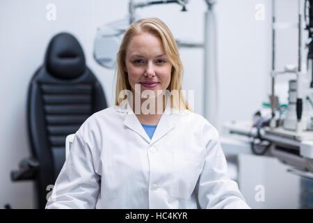 Portrait of smiling female optometrist - Stock Photo