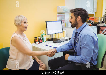 Patient consulting a doctor - Stock Photo