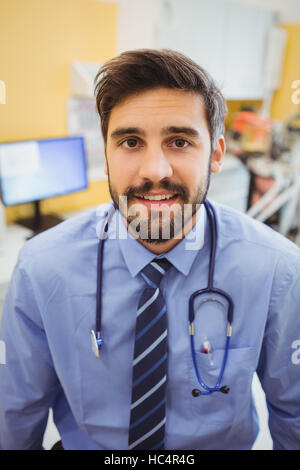Portrait of smiling doctor - Stock Photo