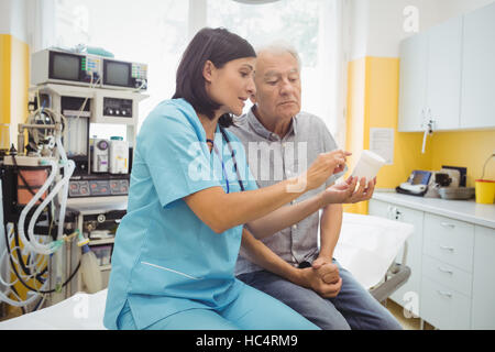 Doctor explaining medicine to his patient - Stock Photo