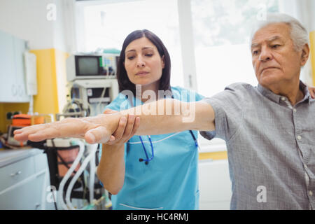 Female doctor examining a patient - Stock Photo