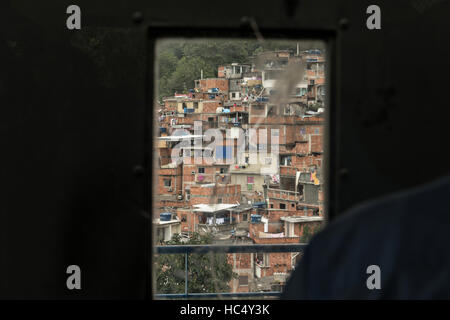View of the Favela Santa Marta from inside the funicular cable tram in Rio de Janeiro, Brazil. - Stock Photo