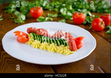 funny meal for kids, sausages and vegetables with mashed potatoes  fresh