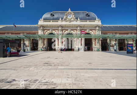 Panorama of the railway station in the center, sunny day, blue sky, a lot of tourists, the area in front of the - Stock Photo