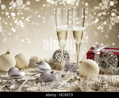 Red gift with white ribbon and two champagne glasses, golden decoration - Stock Photo