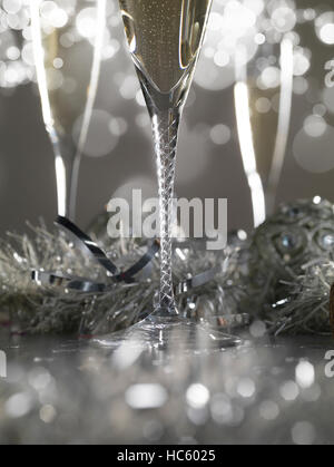 Three luxury champagne glasses on a grey bokeh background - Stock Photo