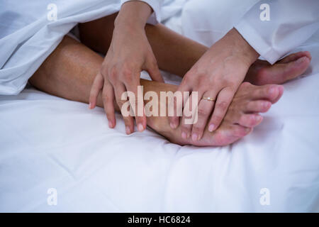 Doctor giving foot treatment to patient - Stock Photo