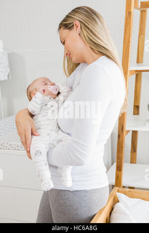Mother holding her baby boy - Stock Photo