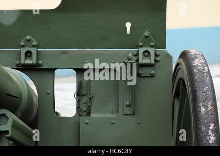 window for viewing in a protective shield on Russia's historical military green gun - Stock Photo