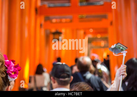 KYOTO, JAPAN - OCTOBER 8, 2016: Unidentified people at walkway in Fushimi Inari shrine in Kyoto, Japan. This popular - Stock Photo