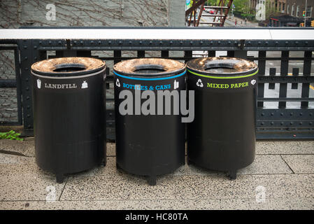 three trash bins for different types of garbage in the streets of new york - Stock Photo