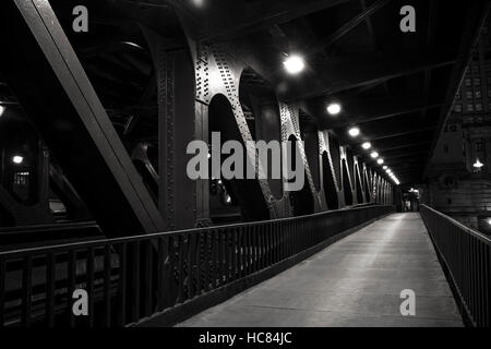 Night photograph of the lower Michigan Avenue Bridge (DuSable Bridge) as it crosses the river, Downtown Chicago, - Stock Photo