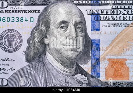 US President Benjamin Franklin portrait on one hundred dollar bill fragment macro - Stock Photo
