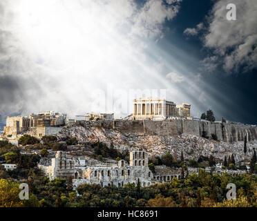 Parthenon Temple on Athenian Acropolis bathed in the Light of Gods, Athens, Greece - Stock Photo