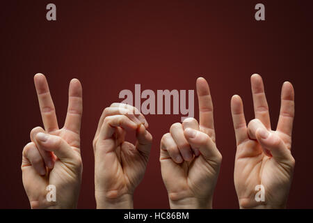 New Year 2017 in sign language over dark red background - Stock Photo