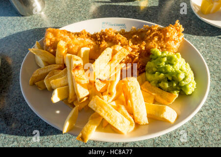 Excellent fish chips  and mushy peas at The Fishermans Wife Cafe in Whitby - Stock Photo