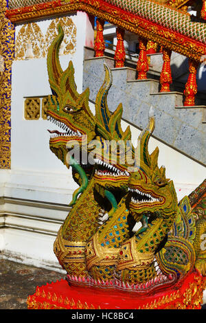 Naga statue at the ordination hall at Wat Buppharam Temple in Chiang Mai, Thailand - Stock Photo