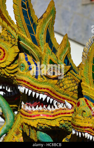 Naga statue at the ordination hall at Wat Buppharam Temple in Chiang Mai, Thailand - Stock Photo