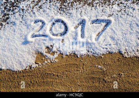 New Year 2017 greeting,  numbers written on snow field, - Stock Photo