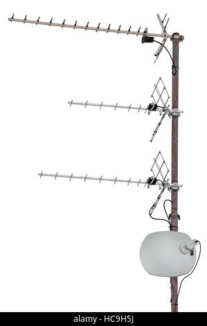 TV and communication aerials on roof of residential house, isolated antennas and satellite dish - Stock Photo