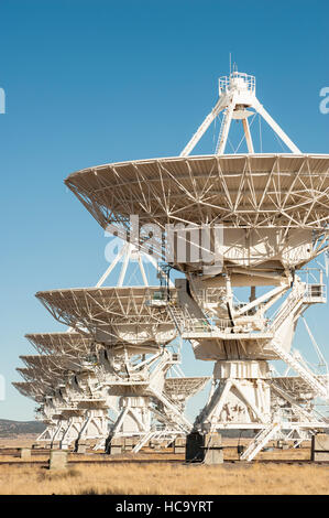 Several radio telescopes pointed vertically to the sky at the Very Large Array (VLA) observatory in New Mexico, - Stock Photo