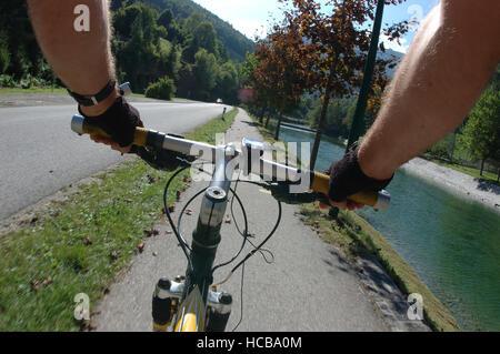 Mountain biking, hands on the handlebars - Stock Photo