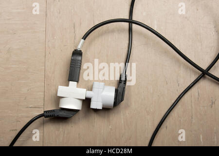 connection of electrical cables on the ground - Stock Photo