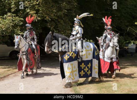Jousting at Le Rivau, mounted knights in full armour - Stock Photo