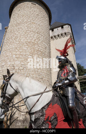 Jousting at the Chateau du Rivau, mounted knight in full armour - Stock Photo