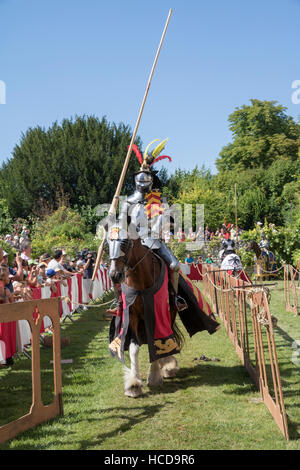 Jousting at the Chateau du Rivau, mounted knight in full armour, with jousting lance - Stock Photo