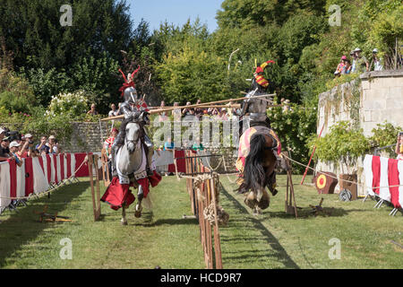 Jousting at the Chateau du Rivau, mounted knights in full armour, spears breaking - Stock Photo