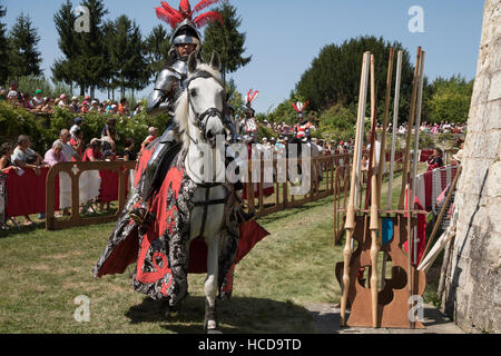 Jousting at Le Rivau, mounted knight in armour - Stock Photo
