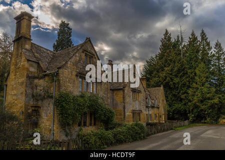 Row of cotswold Stone built cottages in the village of Stanway - Stock Photo