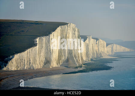 Seven Sisters chalk cliffs. The iconic Sussex coastal view of the South Downs National Park with a low sun - Stock Photo